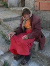 Kosovo - Prizren / Prizreni: old lady with a cigarette - photo by J.Kaman