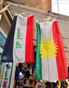 Erbil / Hewler / Arbil / Irbil, Kurdistan, Iraq: flags of Iraq and Kurdistan hang side by side outside a shop in the old town - photo by M.Torres