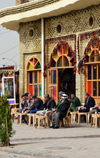 Erbil / Hewler, Kurdistan, Iraq: people enjoy a tranquil moment at Machko Chaikhana, the historic teahouse located at the foot the citadel, on the edge of Shar Park - this teahouse has been a traditional meeting point for the city's intellectuals, journalists, government officials, politicians and foreigners - open since the 1940s and named after its founder Machko Muhammed - photo by M.Torres