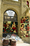 Erbil / Hewler, Kurdistan, Iraq: kitsch souvenirs on display outside a shop at the foot the citadel, on the edge of Shar Park - carpets and plates - photo by M.Torres