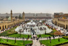 Erbil / Hewler / Arbil / Irbil, Kurdistan, Iraq: main square, Shar Park, with crowds enjoying the pleasantly cool area created by the fountains - arcades on both sides and Nishtiman mall in front - Mosque and Erbil Clocktower on the left - seen from the Erbil citadel - photo by M.Torres