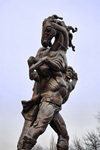 Bishkek, Kyrgyzstan: a man carries his horse - statue at the Palace of Sports - Togolok Moldo street - photo by M.Torres
