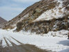 Kyrgyzstan - Chuy oblast: mountain road with snow - winter scene - Central Asian climate - photo by D.Ediev