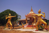 Laos: statues of two war gods in the front of a temple - photo by E.Petitalot