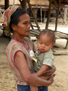Laos - Muang Noi: grandmother with baby - photo by P.Artus