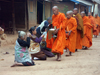 Muang Noi, Laos: Buddhist monks collecting alms - photo by P.Artus