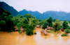 Laos - Vang Vieng - the effects of the monsoon - Nam Song river enters a village - photo by K.Strobel