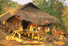 Laos - Si Phan Don region (4000 islands region): a typical bamboo house in a remote village - photo by E.Petitalot