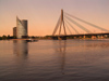 Latvia / Latvija - Riga: dusk on the Daugava - Vansu bridge, a Cable-stayed and the Saules Akmens skyscrapper (photo by J.Kaman)
