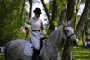 Latvia - Ventspils: a day at the races - Nadya rides a horse (photo by A.Dnieprowsky)