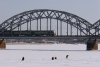 Latvia / Latvija / Lettland - Riga: frozen Daugava - rail bridge - a train heads west - photo by Alex Dnieprowsky