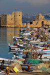 Lebanon, Sidon: fishing boats with view to the crusaders' sea castle - photo by J.Pemberton