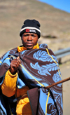 Mohale Dam, Lesotho: shepherd with blanket and woolen hat - photo by M.Torres