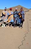 Mohale Dam, Lesotho: four shepherds pose on the road side - photo by M.Torres
