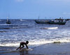 Grand Bassa County, Liberia, West Africa: Buchanan - incipient surfer on the beach - photo by M.Sturges