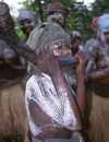 Grand Bassa County: secret society girls - musician playing a horn (photo by M.Sturges)