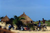 Grand Bassa County, Liberia, West Africa: village life - bamboo benches and thatched roof huts - photo by M.Sturges