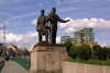 Lithuania - Vilnius: statues at bridge entrance - photo by A.Dnieprowsky