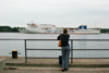 Lithuania - Klaipeda: girl looking at ferry - Lisco Gloria - Lisco Baltic Service - photo by A.Dnieprowsky