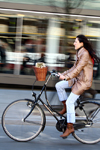 Lithuania - Vilnius: woman riding a bicycle - Gediminas' avenue - photo by Sandia