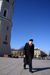 Lithuania - Vilnius: Cathedral square - man going to Sunday Mass - photo by Sandia