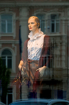 Vilnius, Lithuania: mannequin and buildings reflected in shop window - photo by J.Pemberton