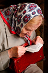 Vilnius, Lithuania: elderly woman reading the Bible in Chapel of the Blessed Mary - photo by J.Pemberton