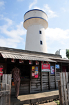 Morondava - Menabe, Toliara province, Madagascar: shop and water tower - photo by M.Torres