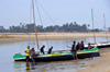 Morondava - Menabe, Toliara province, Madagascar: fishermen bring their boats to shore - Nosy Kely peninsula - photo by M.Torres