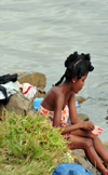 Soanierana Ivongo, Analanjirofo, Toamasina Province, Madagascar: young woman washing herself in the river - photo by M.Torres