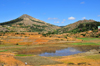 RN2, Alaotra-Mangoro region, Toamasina Province, Madagascar: hills, pond and fields - rural Madagascar - photo by M.Torres