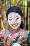 Andoany - Nosy Be / Be island, Antsiranana province, Madagascar: village girl with beauty mask - face cosmetic made from pounded roots of the Olax dissitiflora tree - mussiro - musiro - masonjoany - photo by R.Eime