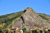 RN2, Alaotra-Mangoro region, Toamasina Province, Madagascar: village under a giant rock pyramid - photo by M.Torres