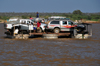 Belo sur Tsiribihina, Menabe Region, Toliara Province, Madagascar: trimaran ferry loaded with 4WDs crosses the Tsiribihina river - aft view - photo by M.Torres
