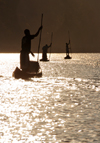 Antsalova district, Melaky region, Mahajanga province, Madagascar: Manambolo River - men in canoes - silhouettes at sunrise - photo by M.Torres
