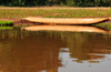 Antsalova district, Melaky region, Mahajanga province, Madagascar: dugout canoe reflected on the Manambolo River - photo by M.Torres