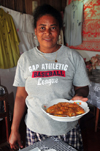 Vohilava, �le Sainte Marie / Nosy Boraha, Analanjirofo region, Toamasina province, Madagascar: the owner of a small restaurant brings prawns to the table - Malagasy dish - photo by M.Torres