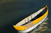 Vohilava, �le Sainte Marie / Nosy Boraha, Analanjirofo region, Toamasina province, Madagascar: yellow and white canoe rests on the quiet and warm waters of the Indian Ocean - photo by M.Torres