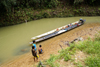 Skandis, Lubok Antu District, Sarawak, Borneo, Malaysia: long boat, outside the Iban longhouse - Kesit River - photo by A.Ferrari