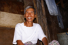 Skandis, Lubok Antu District, Sarawak, Borneo, Malaysia: Happy Iban man, inside the longhouse - Dayak people - photo by A.Ferrari
