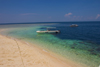 Sipadan Island, Sabah, Borneo, Malaysia: diveboat moored on the white sandy beach - photo by S.Egeberg