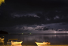 Perhentian Island, Terengganu, Malaysia: Flora Bay - two white boats on beach during a lightning storm - photo by S.Egeberg