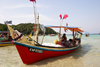 Malaysia - Pulau Perhentian / Perhentian Island, Terengganu: fisherman in his boat (photo by Jez Tryner)