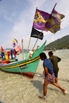 Malaysia - Pulau Perhentian / Perhentian Island, Terengganu: fishermen run - boats with flags (photo by Jez Tryner)