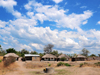 Lake Malombe, Malawi: village houses near a water well - thatched and zinc roofs - photo by M.Torres