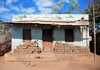 Cape Maclear / Chembe, Malawi: house with piles of mud bricks under a zinc porch - Nankumba Peninsula - photo by M.Torres