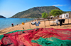 Cape Maclear / Chembe, Malawi: Lake Malawi / Lake Nyasa - colourful fishing nets on the beach and the cape - Nankumba Peninsula - photo by M.Torres