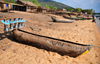Cape Maclear / Chembe, Malawi: hand carved pirogue equipped with lanterns for night fishing - Nankumba Peninsula - photo by M.Torres