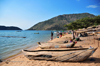 Cape Maclear / Chembe, Malawi: hand carved pirogues an tables of drying Usipa fish / lake sardines on the beach and the cape - David Livingstone named the cape after the astronomer Thomas Maclear - Domwe Island on the left - photo by M.Torres