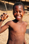 Cape Maclear / Chembe, Malawi: boy on the beach - Yao peole, the Wayao ethnic group, speakers of a Bantu language known as Chiyao - Nankumba Peninsula - photo by M.Torres